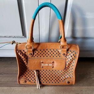 Gianni Bini perforated purse